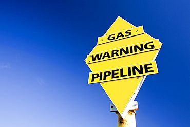 A warning sign for the gas pipeline which brings natural gas from the Morecambe Bay gas field to the gas processing plant in Barrow in Furness, Cumbria, England, United Kingdom, Europe
