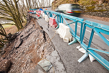 A large section of road collapsed betwwen Skelwyth and Elterwater in the Langdale Valley, Lake District, Cumbria, England, United Kingdom, Europe