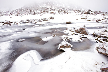 A frozen lochan in Coire an Sneachda in the Cairngorm Mountains, Scotland, United Kingdom, Europe