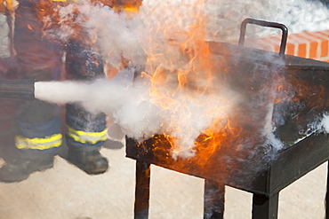 A C02 fire extinguisher being used to put out a blaze in a.fire fighting exercise as part of a BOSIET course for offshore workers, Billingham, Teesside, England, United Kingdom, Europe