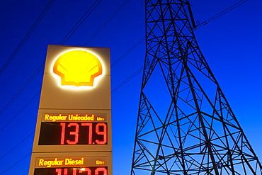 A petrol station and electricity pylon at dusk in Billingham on Teesside, England, United Kingdom, Europe