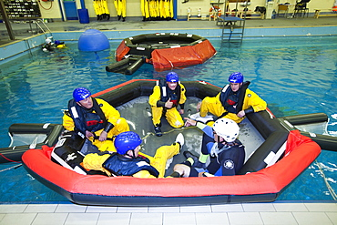 Workers in the offshore industry practise helicopter ditching evacuation as part of an industry training course, Billingham, Teesside, England, United Kingdom, Europe