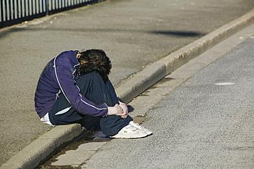 A depressed woman on the streets of Hull, Humberside, England, United Kingdom, Europe