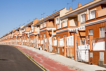 A new build housing development that was abandoned when the Spanish economy collapsed during the recession, causing the developer to become bankrupt, near Sanlucar La Mayor, Spain.