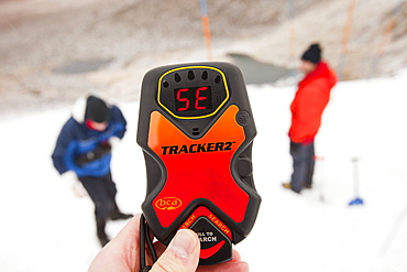 Mountaineers practise using avalanche transceivers in Coire an Lochain in the Cairngorms, Scotland, United Kingdom, Europe