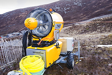 A snow machine in the Cairngorms, surrounded by bare slopes, after poor snow falls in March 2012, Scotland, United Kingdom, Europe