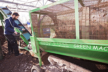 Riddling organic compost at Growing with Grace, an organic fruit and vegetable growing co-operative based in Clapham in the Yorkshire Dales, Yorkshire, England, United Kingdom, Europe
