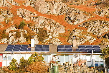 Solar panels on Council houses in Chapel Stile in the Langdale Valley, Lake District, Cumbria, England, United Kingdom, Europe