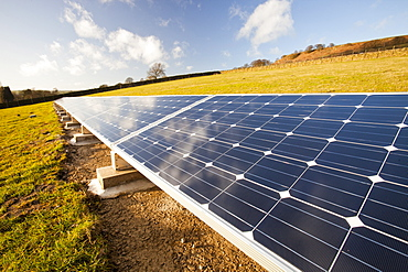 Solar panels in a field behind a farm house powered by them on the edge of Ilkley Moor, West Yorkshire, Yorkshire, England, United Kingdom, Europe
