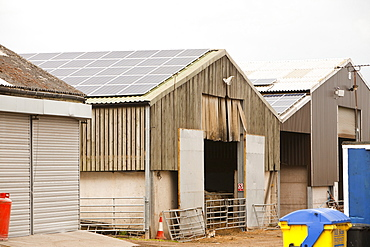 A 35 Kw solar panel system on a barn roof on a farm in Leicestershire, England, United Kingdom, Europe