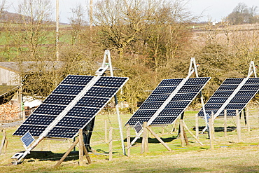 Solar panels and wind turbines on a farm near Woodhouse Eaves in Leicestershire, England, United Kingdom, Europe
