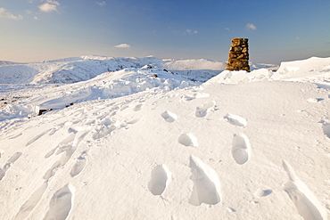 Footsteps up to the summit trig point on Red Screes in the Lake District, Cumbria, England, United Kingdom, Europe