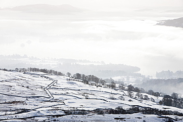 Snow and valley mist over Lake Windermere, looking towards Loughrigg, Lake District, Cumbria, England, United Kingdom, Europe