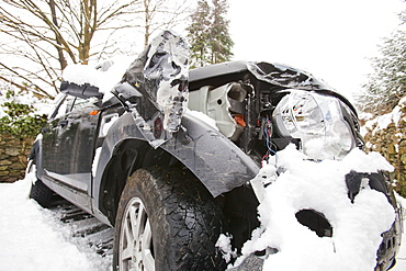 A Land Rover Discovery that slid into a wall in the snow on Kirkstone Pass above Ambleside in the Lake District, Cumbria, England, United Kingdom, Europe