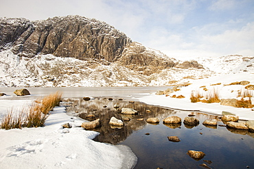 A frozen Stickle Tarn above the Langdale Valley with Pavey Ark in the background, Lake District, Cumbria, England, United Kingdom, Europe