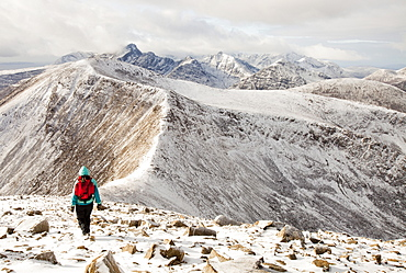 A female hill walker on the hills behind Broadford looking towards the Cuillin ridge on the Isle of skye, Scotland, United Kingdom, Europe