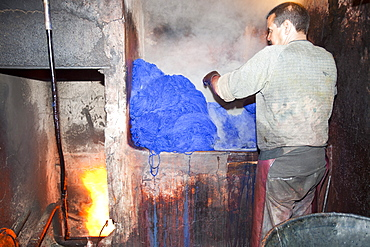 A man dyeing cloth in the dyers souk in Marrakech, Morocco, North Africa, Africa