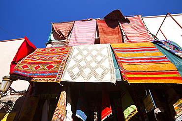 Cloth hanging up a souk in Marrakech, Morocco, North Africa, Africa