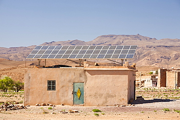 Solar panels on a house roof in a Berber village in the Anti Atlas mountains of Morocco, North Africa, Africa