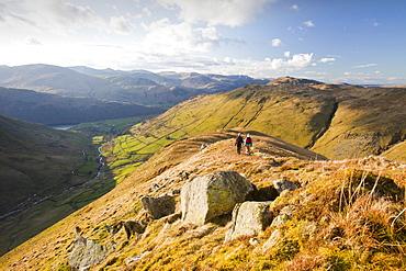 Women walkers descend Gray Crag towards Hartsop in the Lake District, Cumbria, England, United Kingdom, Europe
