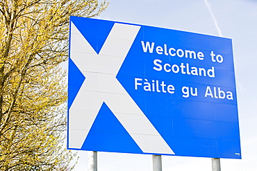 A welcome to Scotland sign on the side of the M74 at Gretna Green, Dumfries and Galloway, Scotland, United Kingdom, Europe