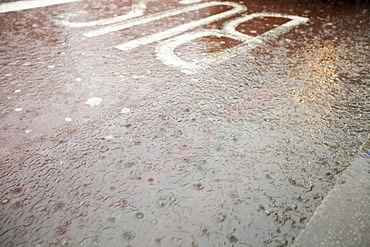 Runoff from a torrential downpour on the streets of Kings Cross, London, England, United Kingdom, Europe