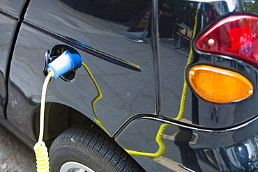 An electric vehicle at a recharging station on the street in Berkeley Square, London, England, United Kingdom, Europe