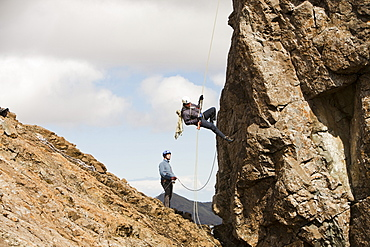 Climbers abseiling from the summit of the Inaccessible Pinnacle onto Sgurr Dearg in the Cuillin mountains, Isle of Skye, Scotland, United Kingdom, Europe
