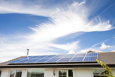 Solar panels on a house in Ambleside, Lake District, Cumbria, England, United Kingdom, Europe