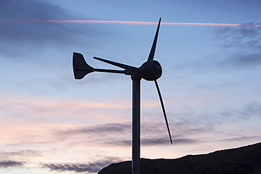 A wind turbine on Kirkstone Pass at sunset, Lake District, Cumbria, England, United Kingdom, Europe