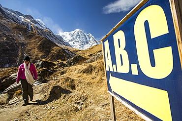 Annapurna South summit with a sign pointing towards the Annapurna Base Camp, Annapurna Sanctuary, Himalayas, Nepal, Asia