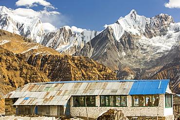 A tea house lodge at Annapurna Base Camp, looking towards the Fish Tail Peak, Himalayas, Nepal, Asia