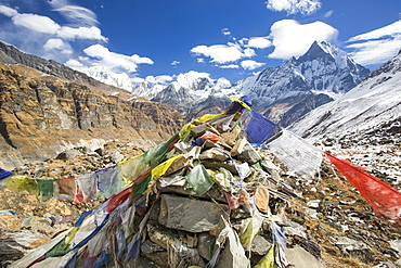 Prayer flags at Annapurna Base Camp at 4130 metres looking towards Machapuchare, Annapurna Sanctuary, Himalayas, Nepal, Asia