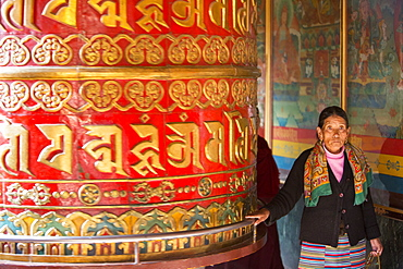 A massive prayer wheel at the Boudhanath Stupa, one of the holiest Buddhist sites in Kathmandu, Nepal, Asia