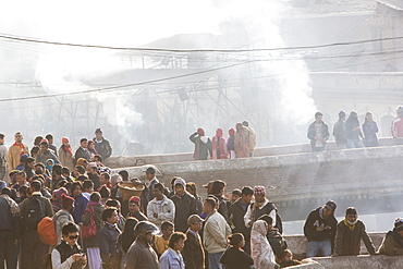 A cremation ceremony at the Pashupatinath Temple, a Hindu temple of Lord Shiva on the banks of the Bagmati River, UNESCO World Heritage Site, Kathmandu, Nepal, Asia
