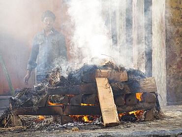 A cremation at the Pashupatinath Temple, a Hindu temple of Lord Shiva on the banks of the Bagmati River, UNESCO World Heritage Site, Kathmandu, Nepal, Asia
