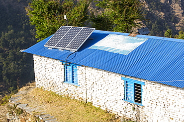 Solar photo voltaic panels on the rooftops of a school in Ladruk in the Himalayan foothills, Nepal, Asia