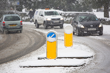 Cars driving through heavy snow in Ambleside, Lake District, Cumbria, England, United Kingdom, Europe