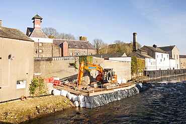 Constructing flood defences on the River Cocker in Cockermouth, Cumbria, England, United Kingdom, Europe