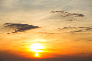 The sun setting over the Irish Sea from Hardknott Pass, in the Lake District, Cumbria, England, United Kingdom, Europe