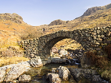 Lingcove Bridge, an ancient packhorse bridge over Lingcove Beck in the Upper Esk valley in Eskdale, Lake District, Cumbria, England, United Kingdom, Europe