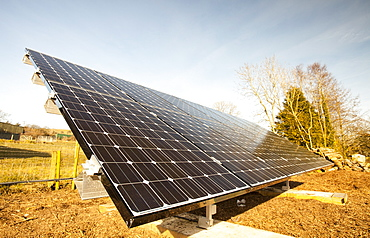Solar panels fitted in an garden of a house in Gosforth, Eskdale, Cumbria, England, United Kingdom, Europe