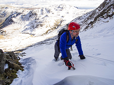 A climber in Custs Gully on Great End, a grade one winter route, Lake District, Cumbria, England, United Kingdom, Europe