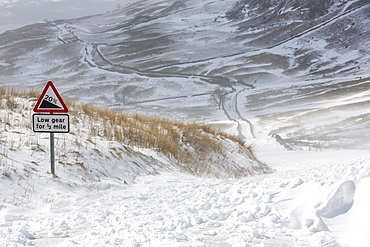 Massive snow drifts block the Kirkstone Pass road above Ambleside in the Lake District, Cumbria, England, United Kingdom, Europe
