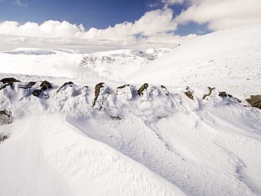 A wall and wind sculpted snow on High Street in unseasonally cold weather in late March 2013, Lake District, Cumbria, England, United Kingdom, Europe