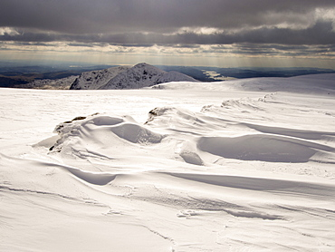 The Kentmere Fells and Lake Windermere from High Street in unseasonally cold weather in late March 2013, with wind sculpted snow, Lake District National Park, Cumbria, England, United Kingdom, Europe