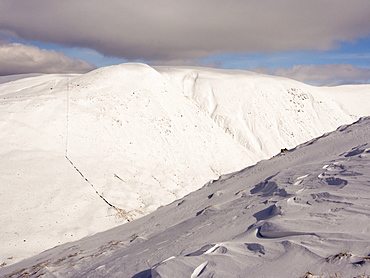Wind sculpted snow on Gray Crag during unseasonally cold weather in late March 2013, Lake District, Cumbria, England, United Kingdom, Europe