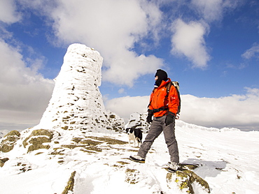 Thornthwaite Beacon plastered in hoar frost in unseasonally cold weather in late March 2013, with a hardy fell walker, Lake District, Cumbria, England, United Kingdom, Europe