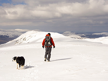 A walker on Gray Crag looking north in unseasonally cold weather in late March 2013, Lake District, Cumbria, England, United Kingdom, Europe