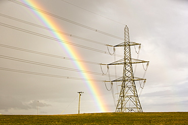A rainbow over electricity pylons leaving Wylfa nuclear power station on Anglesey, Wales, United Kingdom, Europe